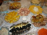 Table spread- smoked fish with olives, placinta (pastry), meats, and cheeses